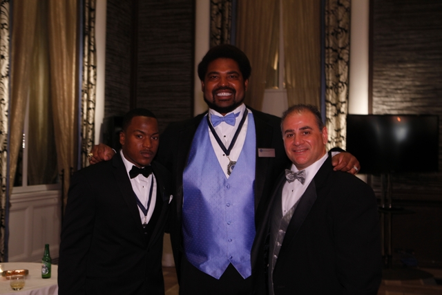 Shane Zackery and Mike Feminis are impressed with the sheer size of 2012 NFF Hall of Fame Inductee, Jonathan Ogden. Ogden was an offensive tackle at UCLA (1992-95) and also won a Super Bowl with the Baltimore Ravens in 2000. � at Waldorf Astoria N