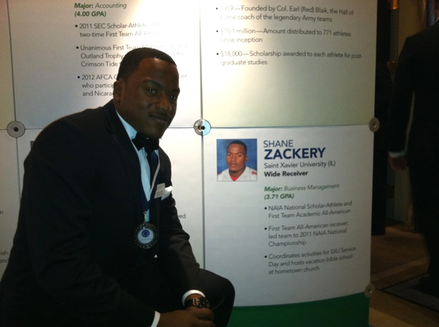 Shane Zackery poses next to his bio that highlighted each of the National Scholar-Athletes and was on display at the Waldorf Astoria throughout the two-day event. � at Waldorf Astoria New York.