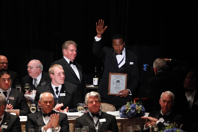 Shane Zackery waves to the crowd of 1,700 spectators moments after accepting his award.
