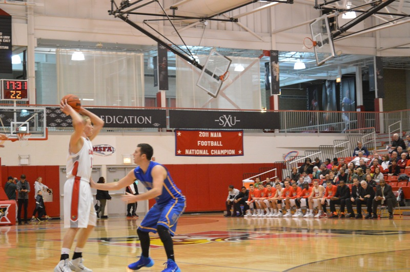 1st SXU Men's Basketball vs Madonna (Mich.) 11/29/13 Photo