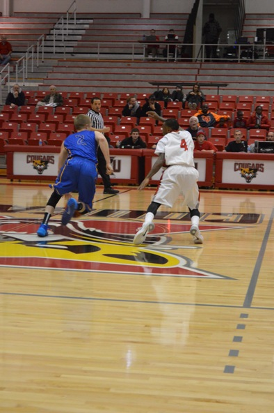12th SXU Men's Basketball vs Madonna (Mich.) 11/29/13 Photo