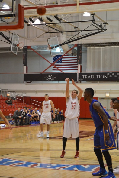 21st SXU Men's Basketball vs Madonna (Mich.) 11/29/13 Photo