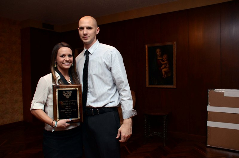 Inductee Lissa Coby with women's soccer coach Evan Strehlau