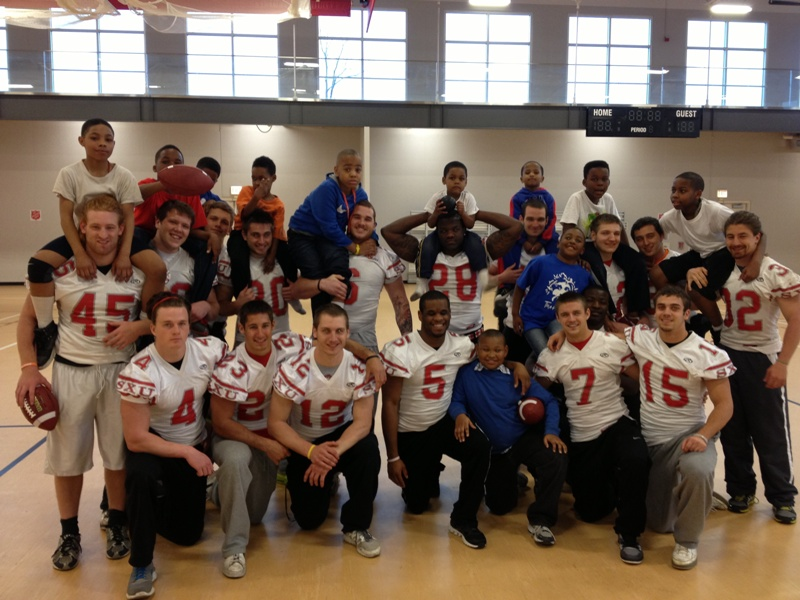 The SXU players had a great time teaching football to the children at the The Salvation Army Ray and Joan Kroc Corps Community Center.