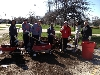 Some of the players help spread fresh mulch around Mt. Greenwood Park.