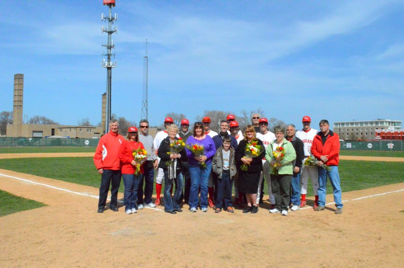 A group shot of all the seniors and their parents at home plate
