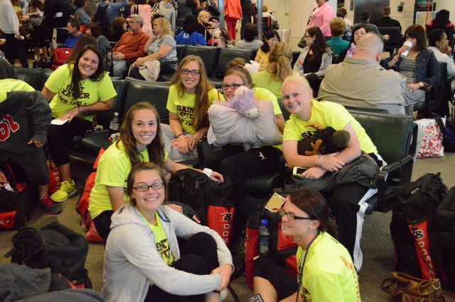Members of the SXU softball team get a group shot in at Midway Airport.