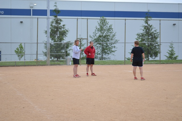 The SXU softball coaching staff gets ready for practice.
