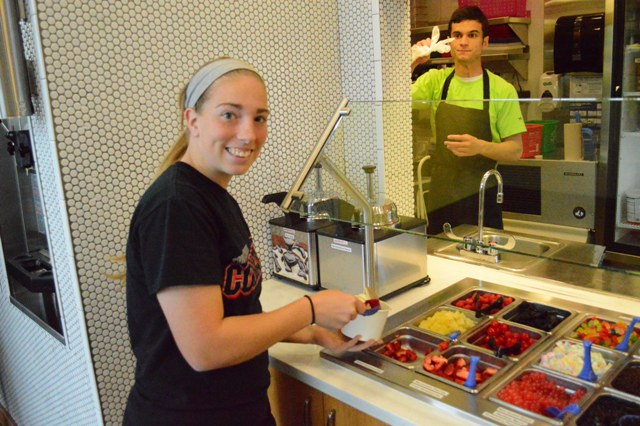 Junior Ariel Hinton tries out the topping bar at YoCream.
