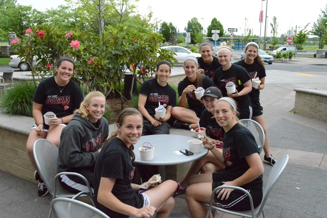 The SXU softball team enjoying the weather and their frozen yogurt.