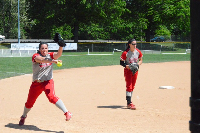 The Nonnemacher sisters warm up their arms before Monday's game.