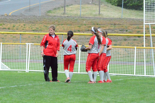 Coach Myra Minuskin instructs some of the team in the outfield.
