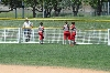 Some of the SXU players try to help fix the outfield fences before the game Monday.