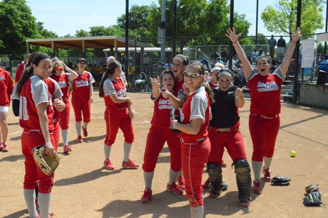 SXU players gather to celebrate after their victory on Tuesday