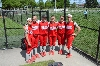 Some of the SXU players pose in the dugout during Tuesday's game