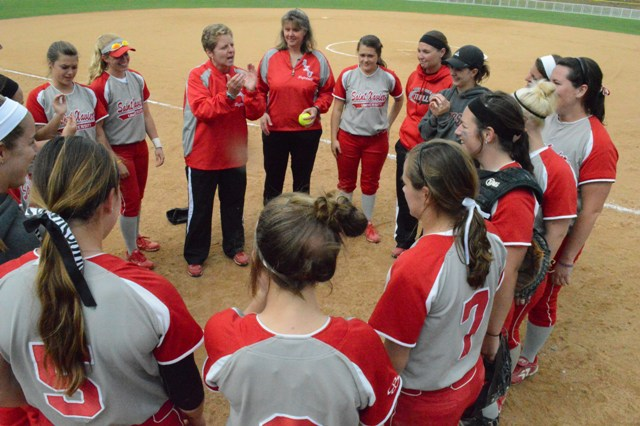 Coach Myra Minuskin addresses her team on the field after the victory