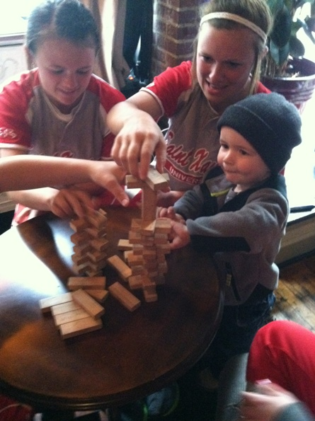 The Houlihan sisters make a friend following Wednesday's championship dinner!  Jenga, anyone?