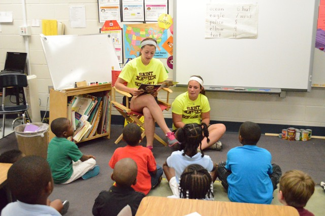 Freshman Denise Anderson and sophomore Megan James reading to some students. Denise did a lot of reading today.