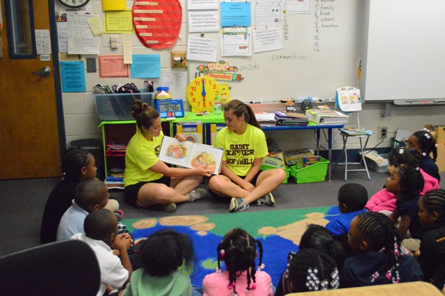 Sohomore sisters Sarah and Samantha Saunders (try saying that five times fast) reading to some students.