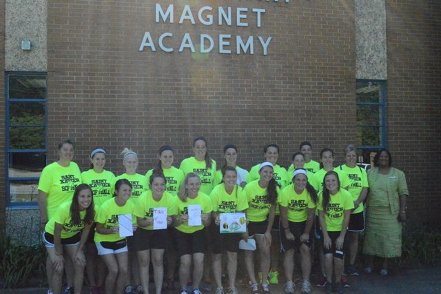 The team as well as principal Dr. Williams in front of Dimon Elementary Magnet Academy.