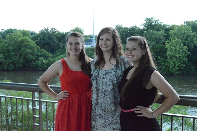 Sophomore Sarah Saunders, freshman Denise Anderson and sophomore Samantha Saunders pose outside before the banquet.