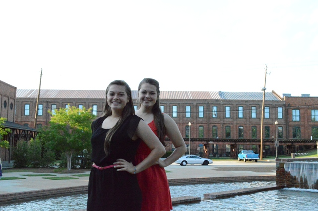 Sophomore sister's Samantha and Sarah Saunders pose in front of a fountain after the banquet.