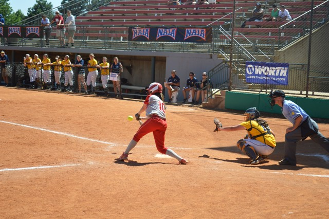 Senior Ashley Sullivan making contact on a ball for a base-hit up the middle.