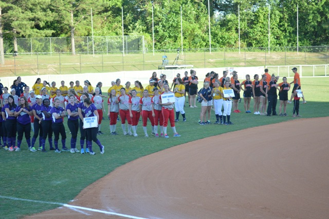 The team standing in the outfield during the Parade of Champions.