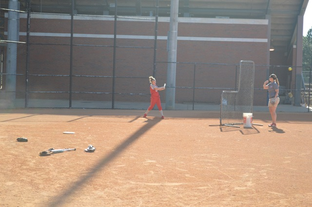 Sophomore Erin Mollohan takes some batting practice before the game.