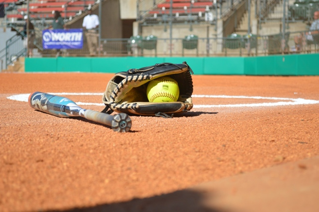 And the final artistic shot of a glove, a softball and a bat.