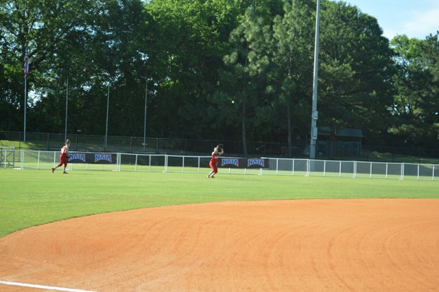 Sophomore Shannon Lauret making a catch before the game, sophomore Erin Houlihan backs her up.