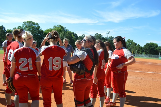 Coach Myra Minuskin talks with the team before the start of the game.