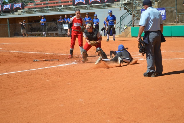 Sophomore Megan James forces a runner out at home after a throw from senior Ashley Sullivan (not pictured)