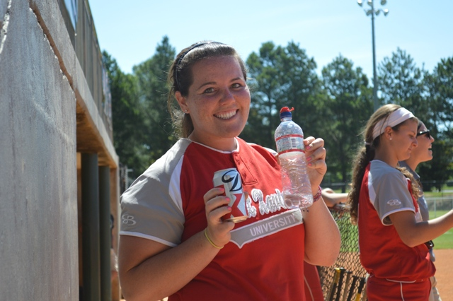 Junior Megan Nonnemacher making sure to stay hydrated on a warm day.