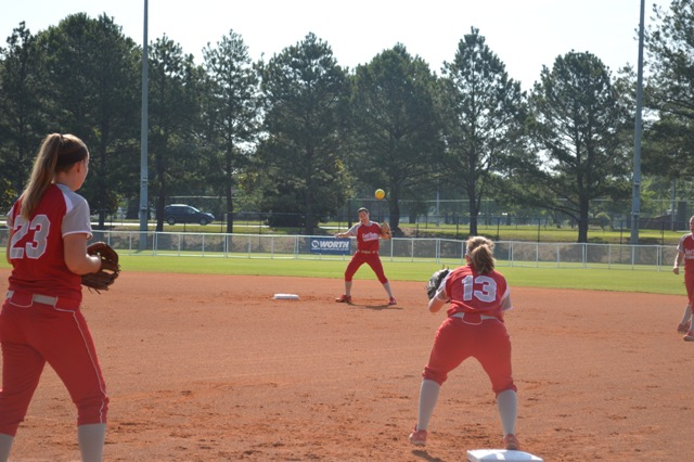 Senior Ashley Sullivan fires a throw over to junior Ariel Hinton during pre-game warm-ups.