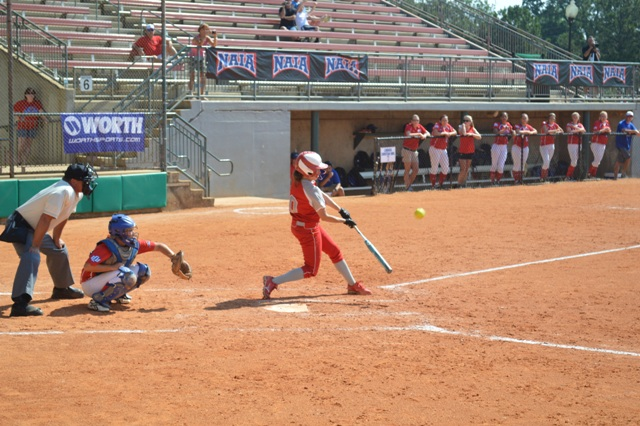 Senior Ashley Sullivan drives a pitch during an at-bat.