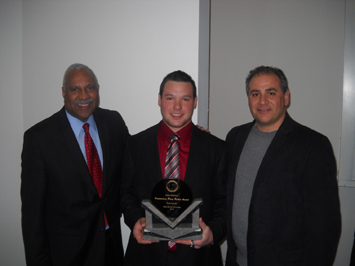 Junior Tom Lynch (middle) poses with Fred Mitchell (left) and SXU football coach Mike Feminis (right)