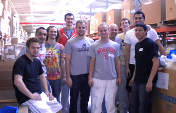 SXU Men's Soccer spent over three hours sorting medical supplies for Mission Outreach