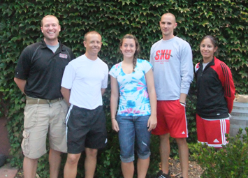 Cassie Pullia (middle) with the SXU women's soccer coaching staff