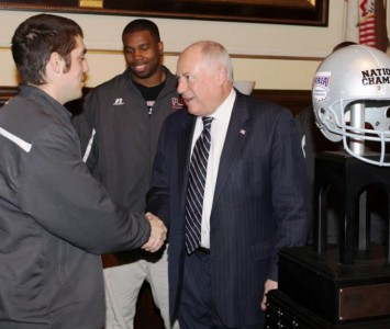 Junior center Matt Munizzi shakes hands with Gov. Quinn at the State Capitol Wednesday