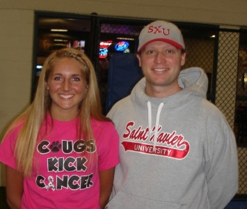 Alexis Cozzi of Lockport and SXU women's soccer coach Jeremy Ekeler at the signing
