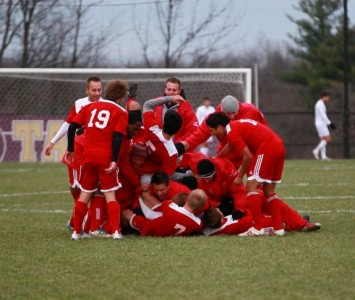 The SXU men's soccer team celebrates after its thrilling 1-0 win in 2OT (photo by Tim Riethmiller)