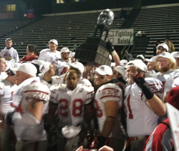 SXU players hoist the NAIA national championship trophy Saturday evening