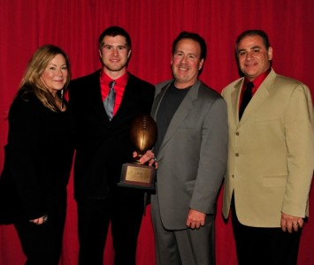 Senior Jimmy Coy - 2012 Rawlings-NAIA National Football of the Year with parents and SXU head coach Mike Feminis (right)