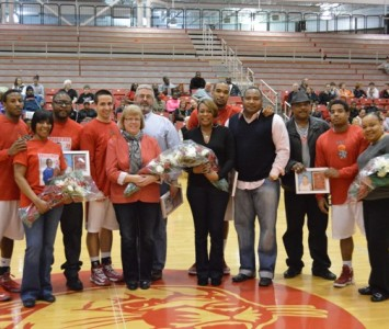 From left, seniors Anthony Grant, Mike Beutel, Dominique Harvey and Roosevelt Green were honored with their families prior to