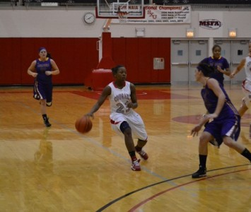 Junior Niara Harris scored 18 points off the bench Thursday for the Cougars against Ashford
