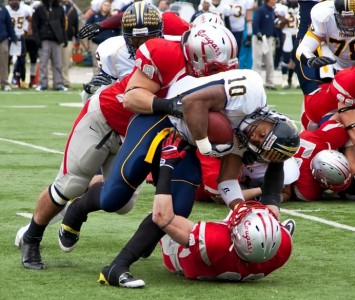 Senior Mike Bushnell and sophomore Clayton Fejedelem combine for the tackle against Marian Saturday