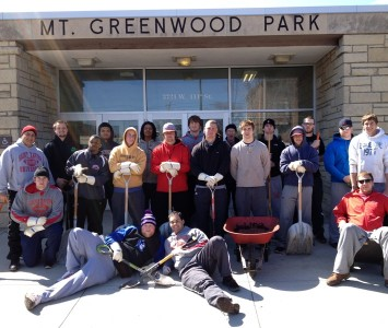 Several Saint Xavier football players volunteered time to help clean Mount Greenwood Park Saturday