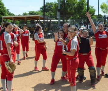 The SXU softball team celebrates after its 2-0 victory over Corban (Ore.) Tuesday