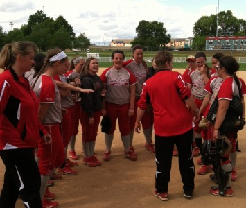 THe SXU softball team was all smiles after its 12-1 victory over MidAmerica Nazarene Monday
